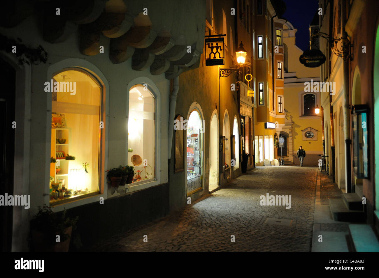 ancient city regensburg in germany with shopping street at night stock photo royalty free image. Black Bedroom Furniture Sets. Home Design Ideas