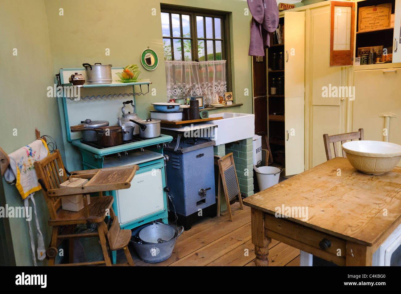 Kitchen in a traditional british home in the 1930s stock for Traditional kitchen equipments