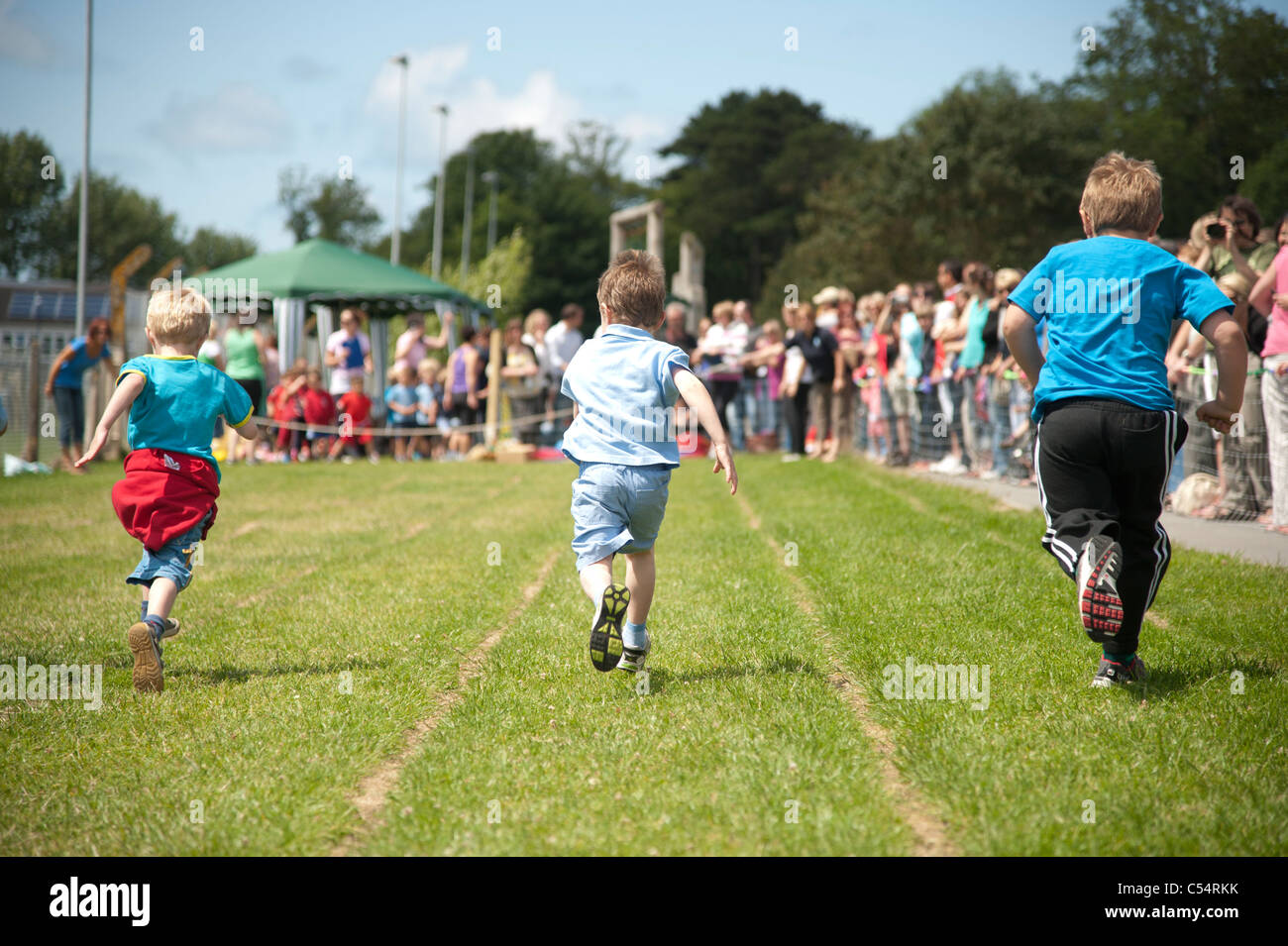 Young small boys racing at the annual School sports day at a small primary school, UK Stock Photo
