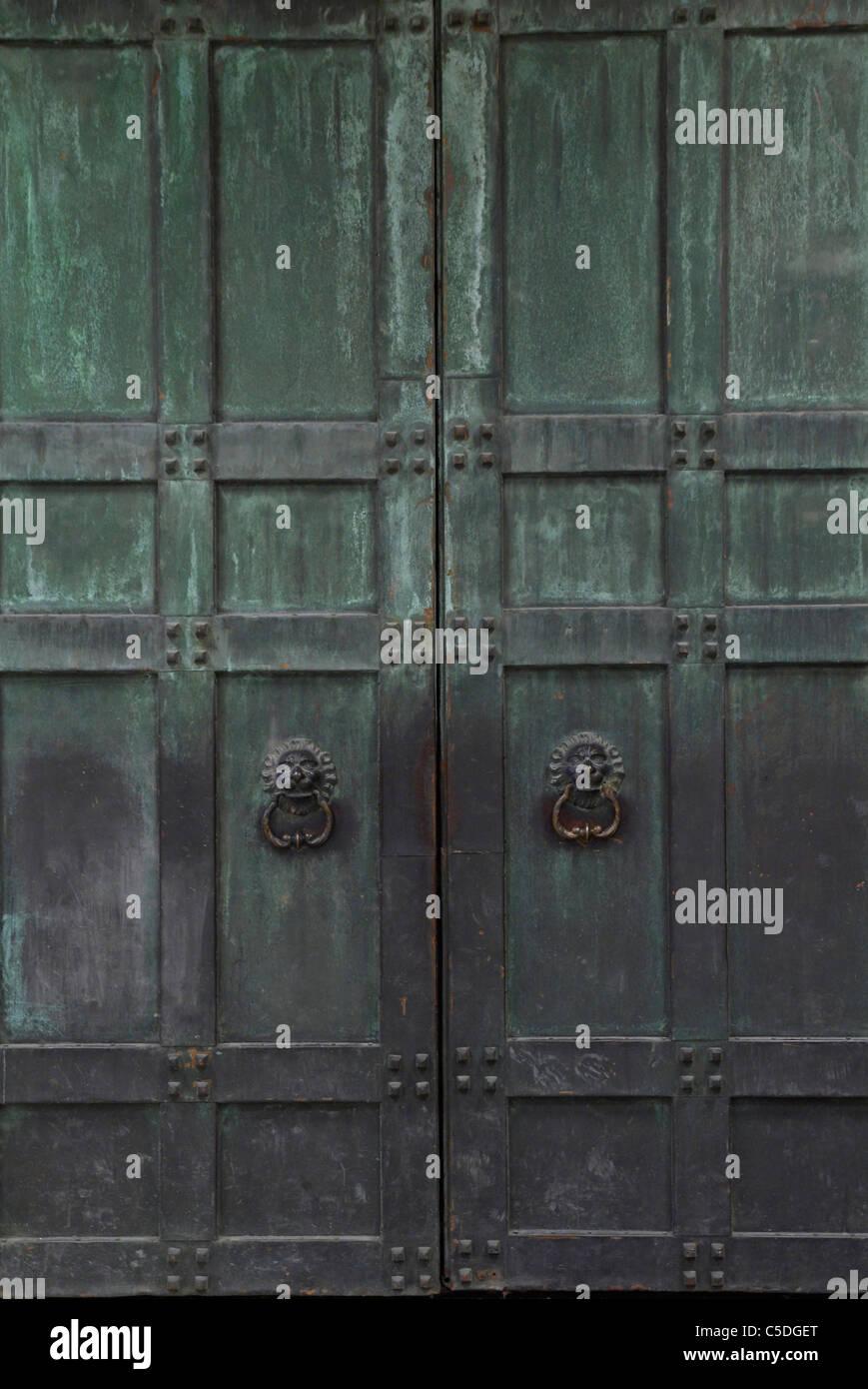 Big Metal Door : Background of closed ancient large metal door stock photo