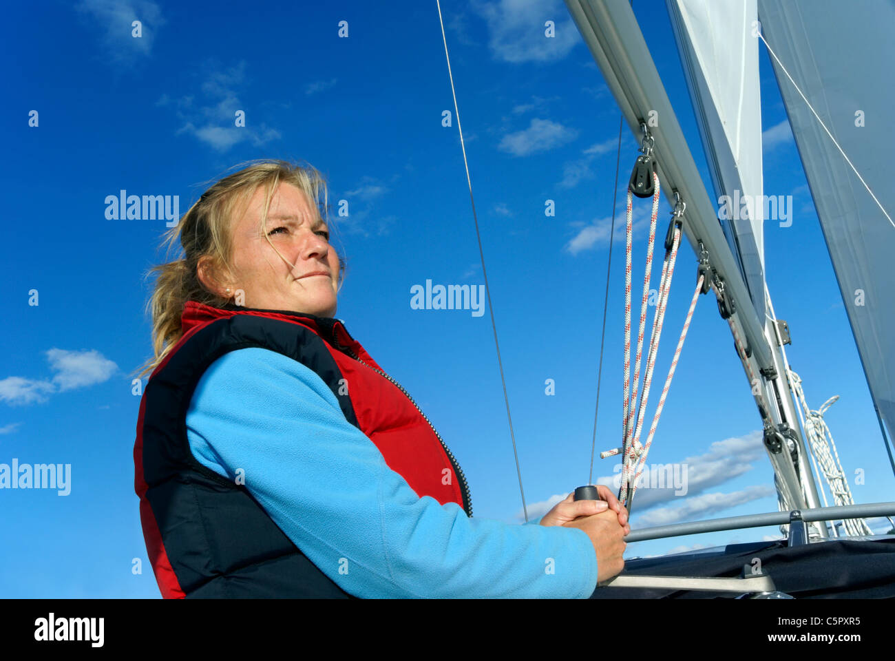 blond-woman-sailing-yacht-model-release-