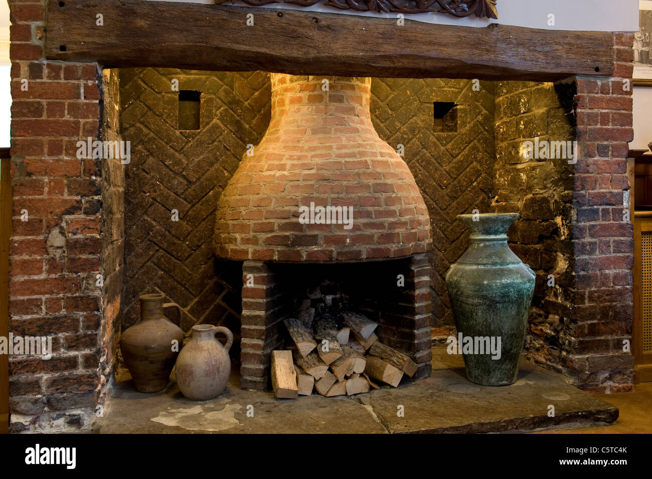 Old brick beehive inglenook fireplace with oak beam and