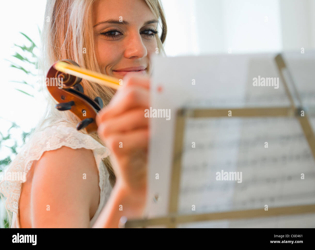 USA, New Jersey, Jersey City, Woman composing music Stock Photo