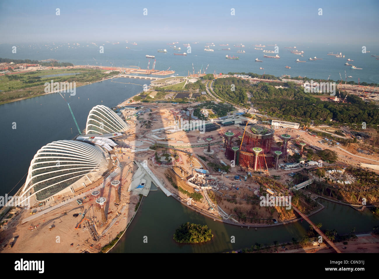 Land reclamation and new building in singapore seen from for Build house on your land