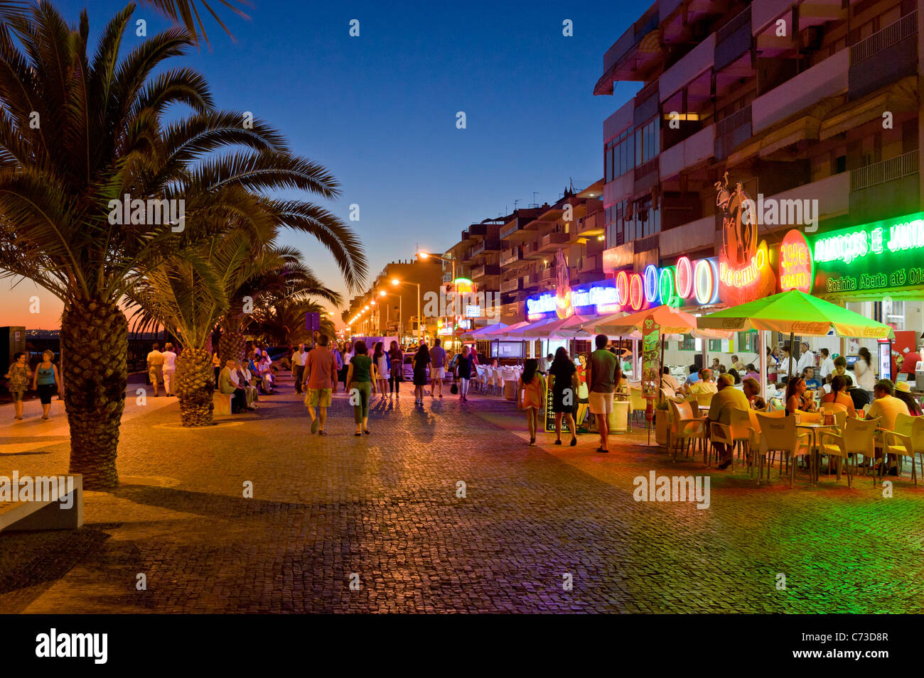 Quarteira Portugal  City pictures : Portugal, The Algarve, Quarteira Promenade At Dusk Stock Photo ...