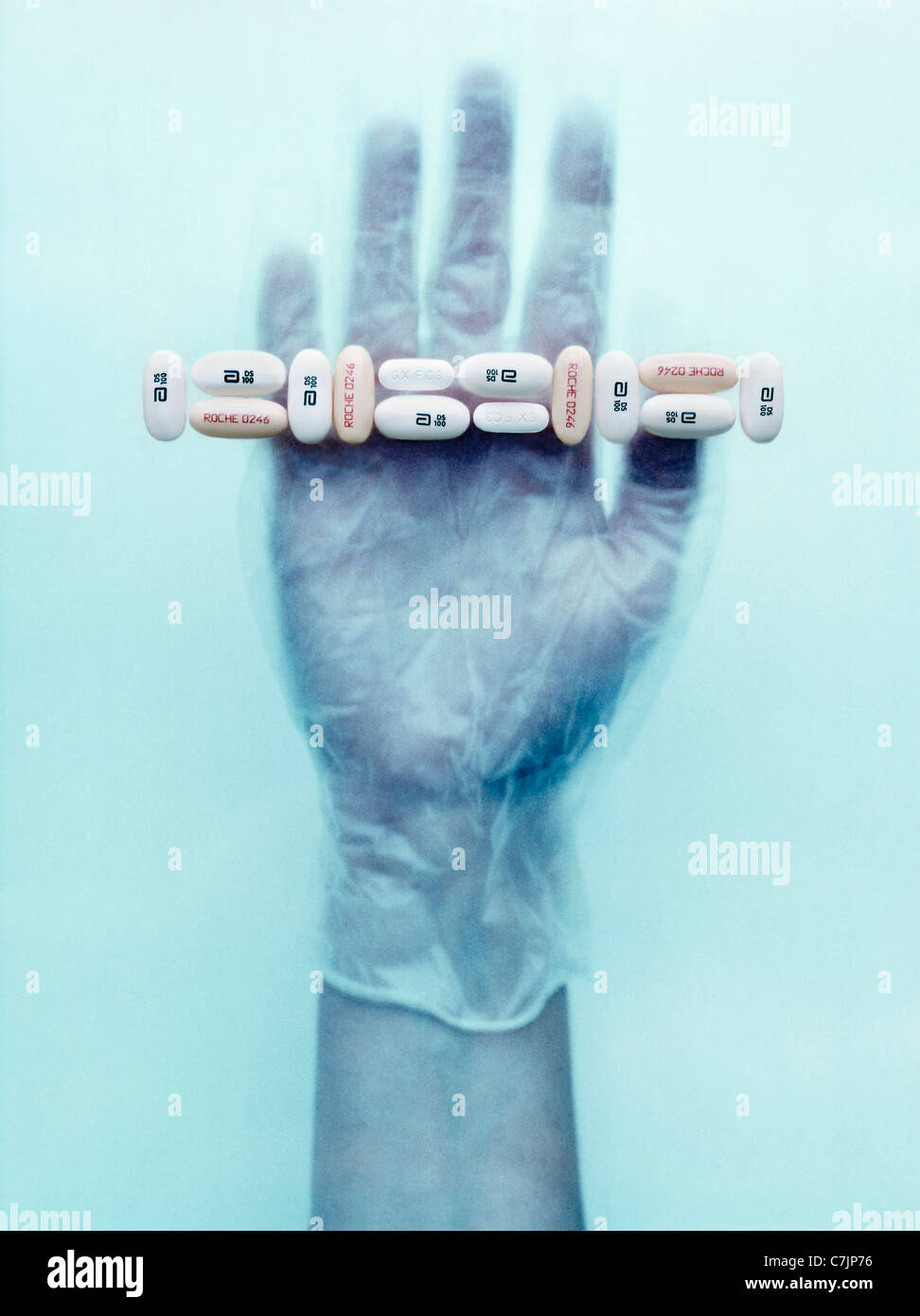 Gloved hand holding pills Stock Foto