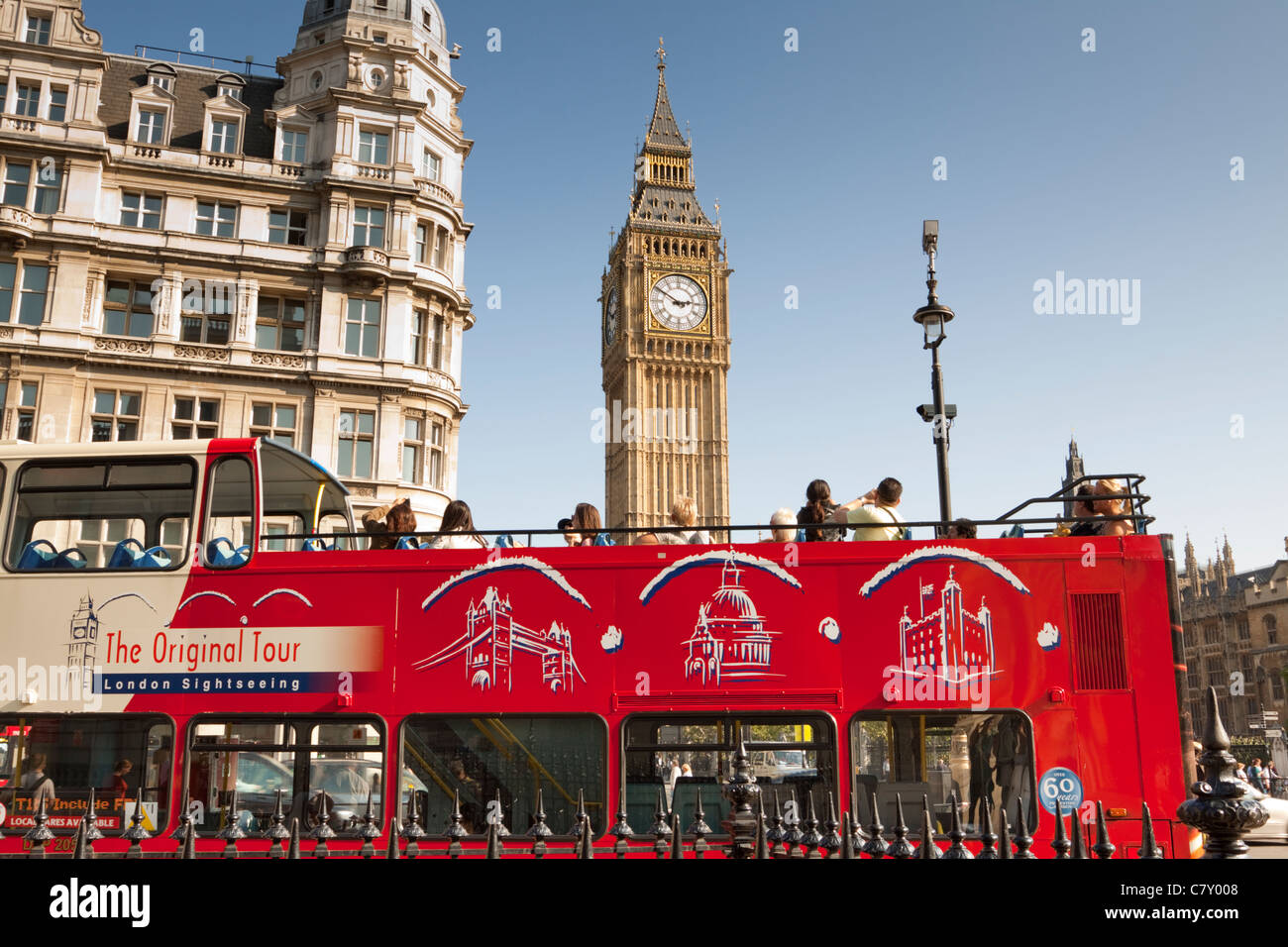 red-open-top-tourist-bus-with-big-ben-in