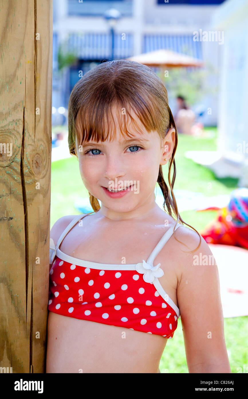 Bikini kid girl water wet in pool garden holding sunroof pole stock photo royalty free image - Kleine teen indelingen meisje ...