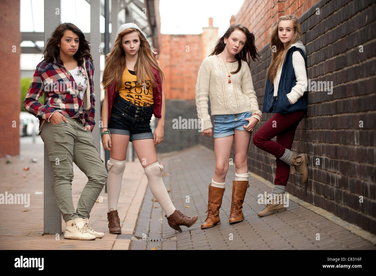 A Group Of 4 Four 13 Year Old Teenage Girls Moody With