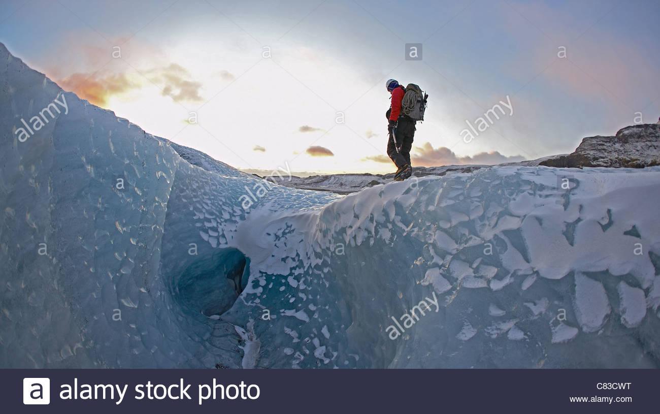 Man walking on glacier Stock Foto