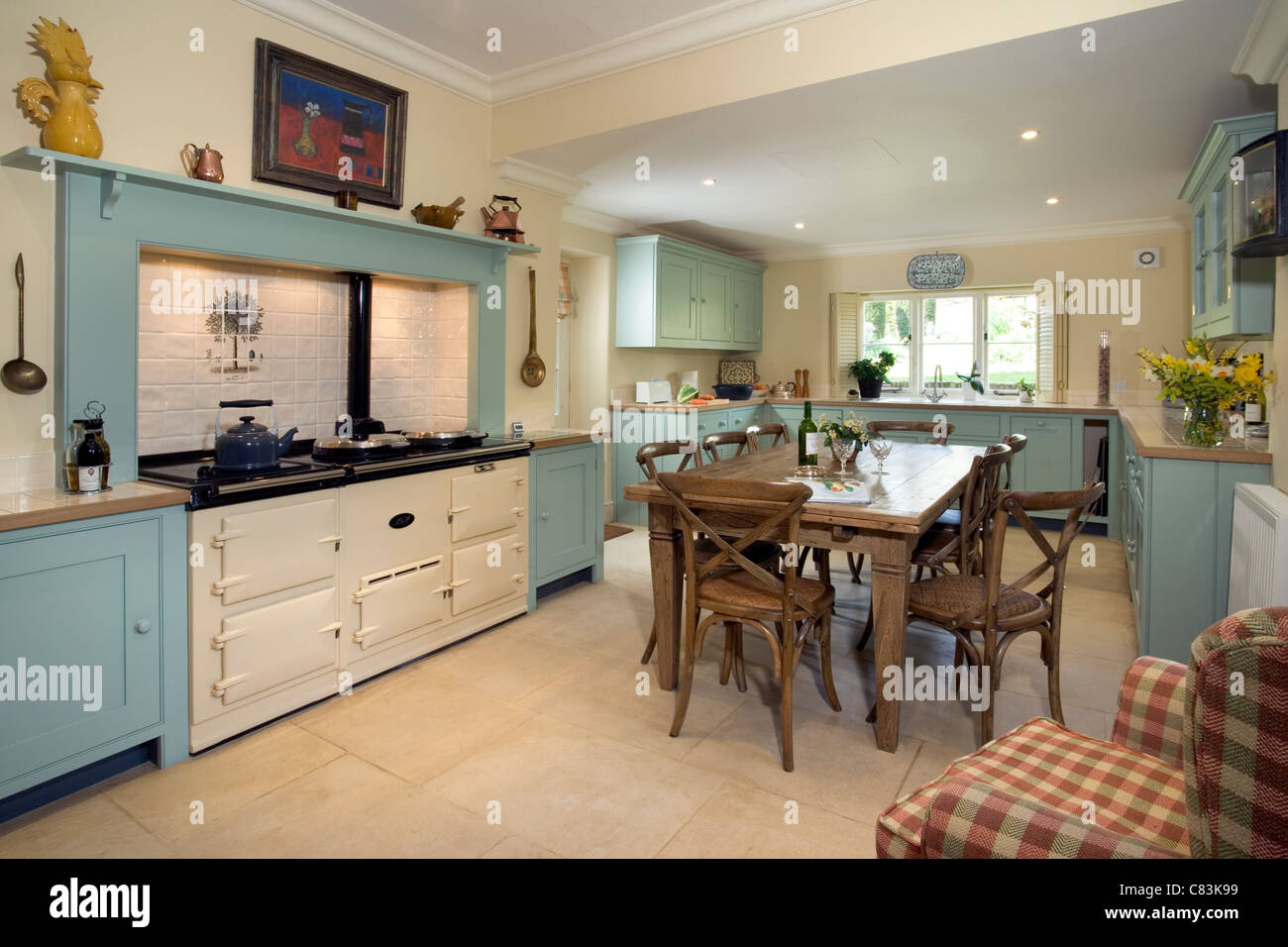 Contemporary farmhouse style kitchen with aga cooker stock for Farm style kitchen pictures