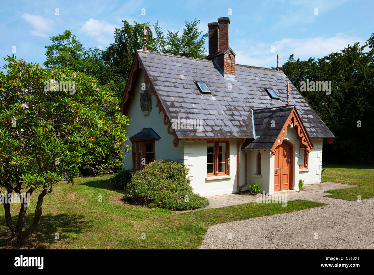 Small Irish Cottage Situated In A Wooden Area Stock Photo