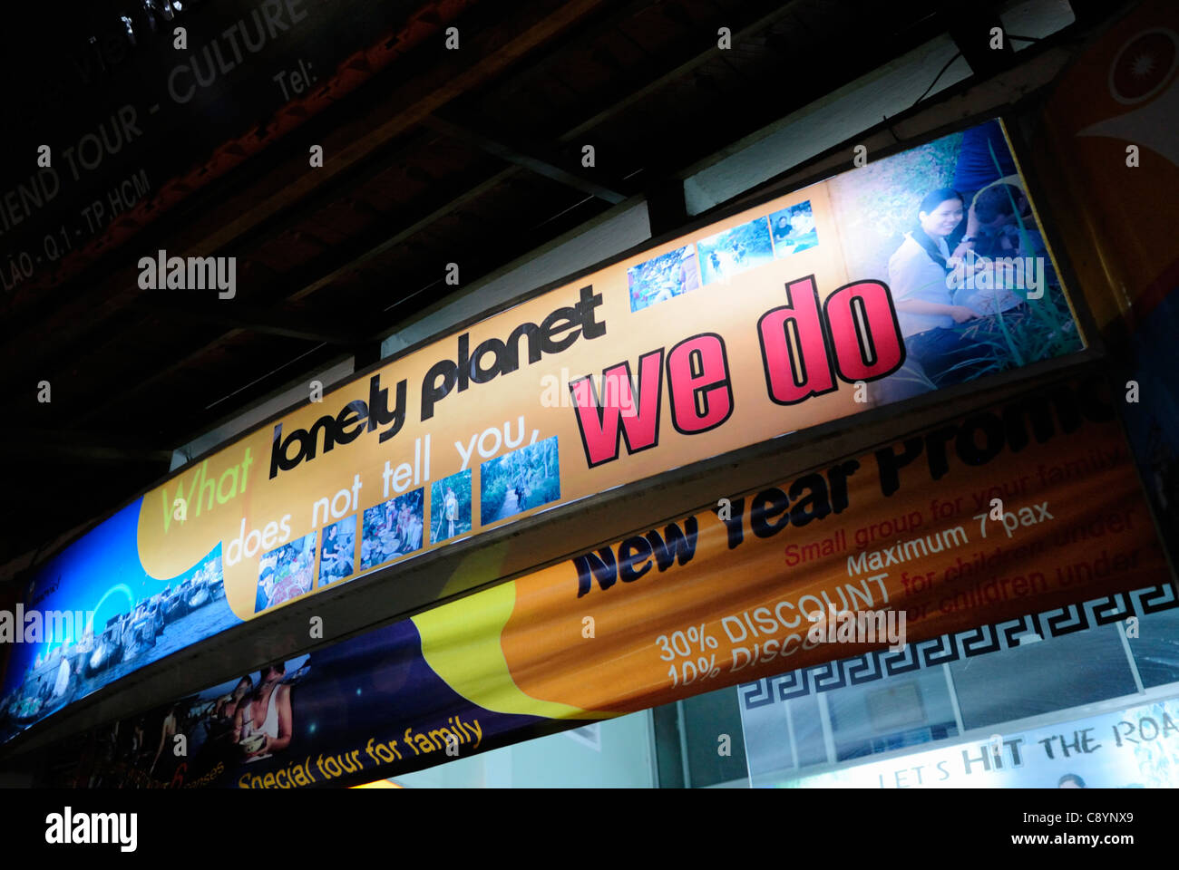 Stock Photo - Asia, Vietnam, Ho Chi Minh City (Saigon). Travel agency in the backpackers area around Pham Ngu Lao / Bui Vien St. advertisin