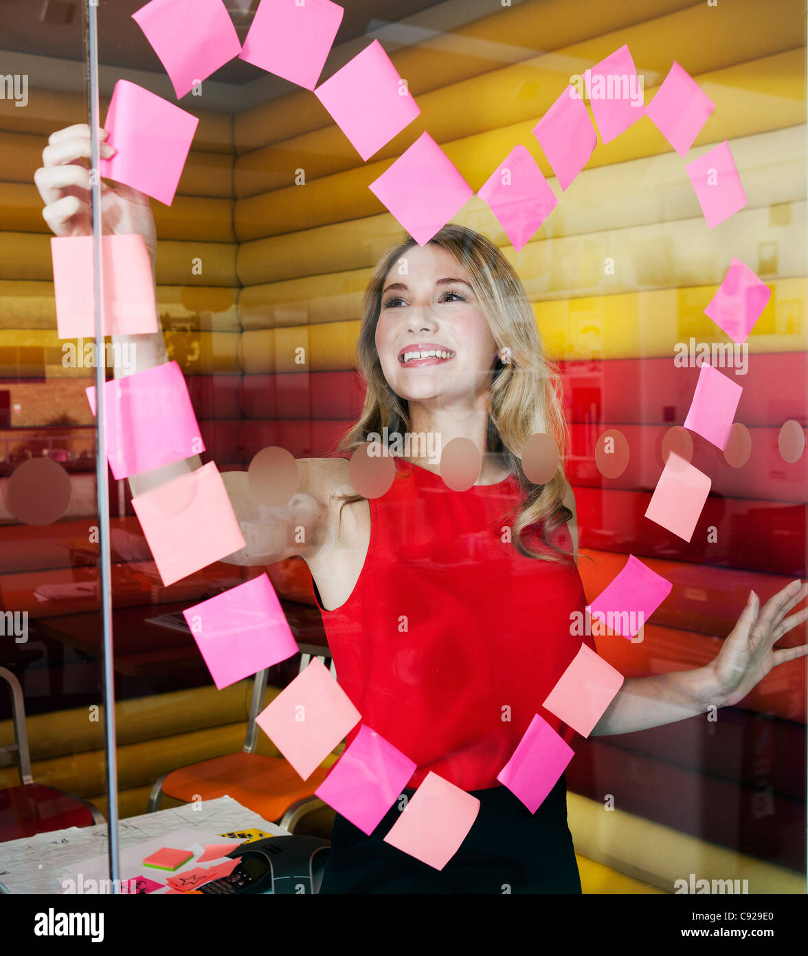 Businesswomen making heart with notes Stock Foto
