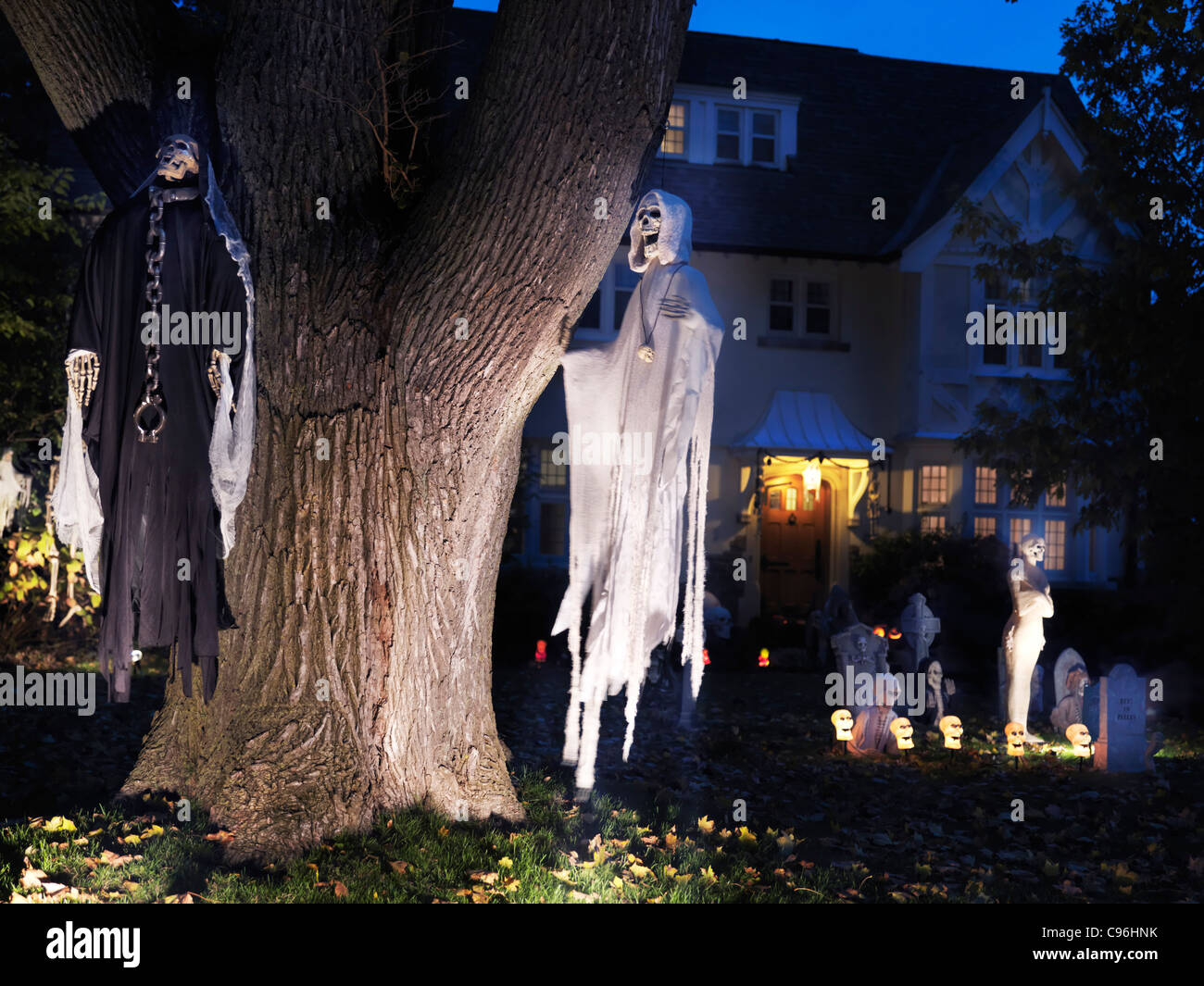 Spooky Halloween Decoration. Ghosts And Cemetery In The Front Yard Of Stock Photo Royalty Free ...