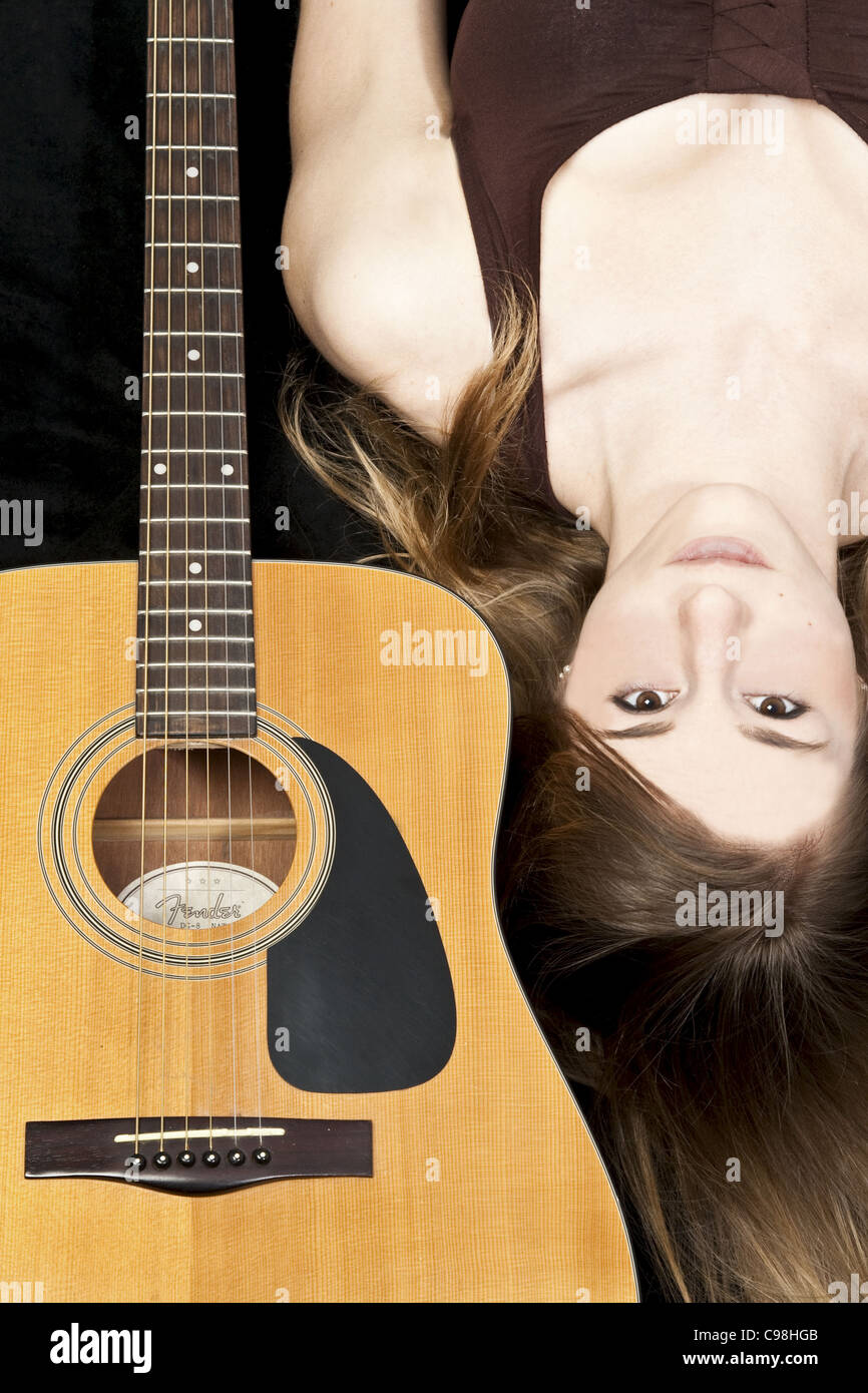 Colour Portrait of a young girl with a Fender Acoustic Guitar Stock Photo