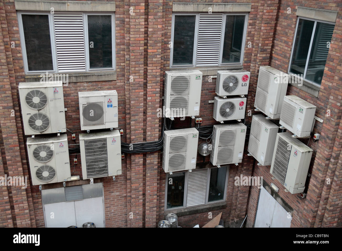 An Office Block Wall Full Of Ugly Air Conditioning Units