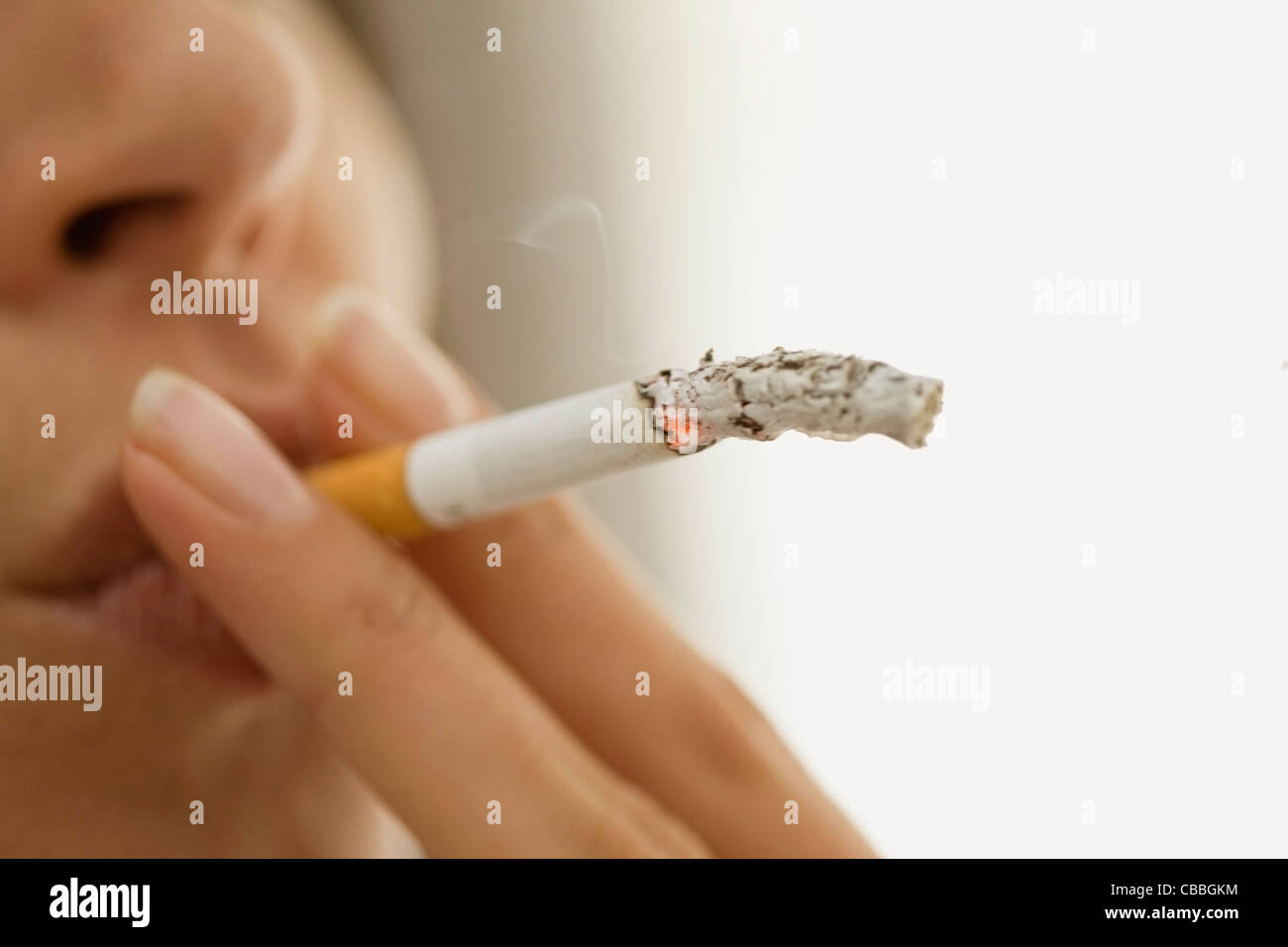 Close up of woman smoking cigarette Stock Photo