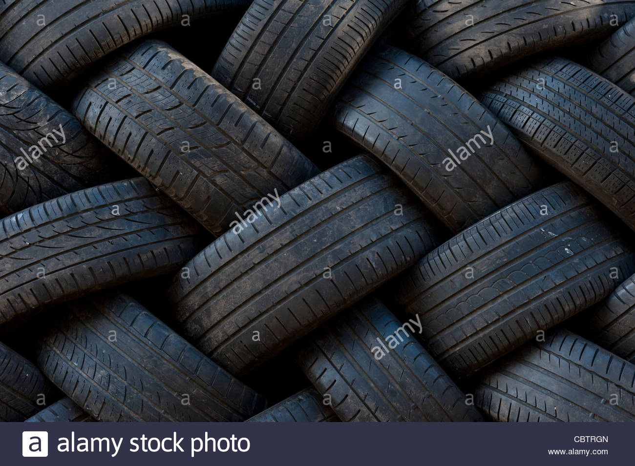 Car tyres stacked up at garage Stock Foto