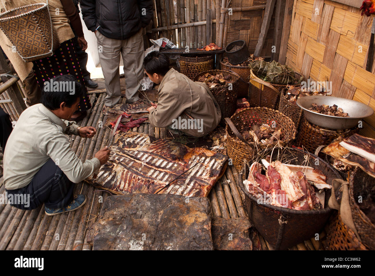India arunachal pradesh ziro valley mida men preparing for Arunachal pradesh cuisine