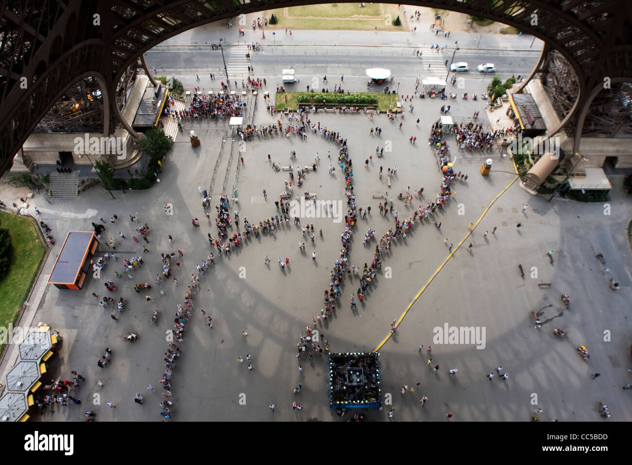 View from Eiffel Tower, of visitors queue up to enter. Paris, France. Stock Photo