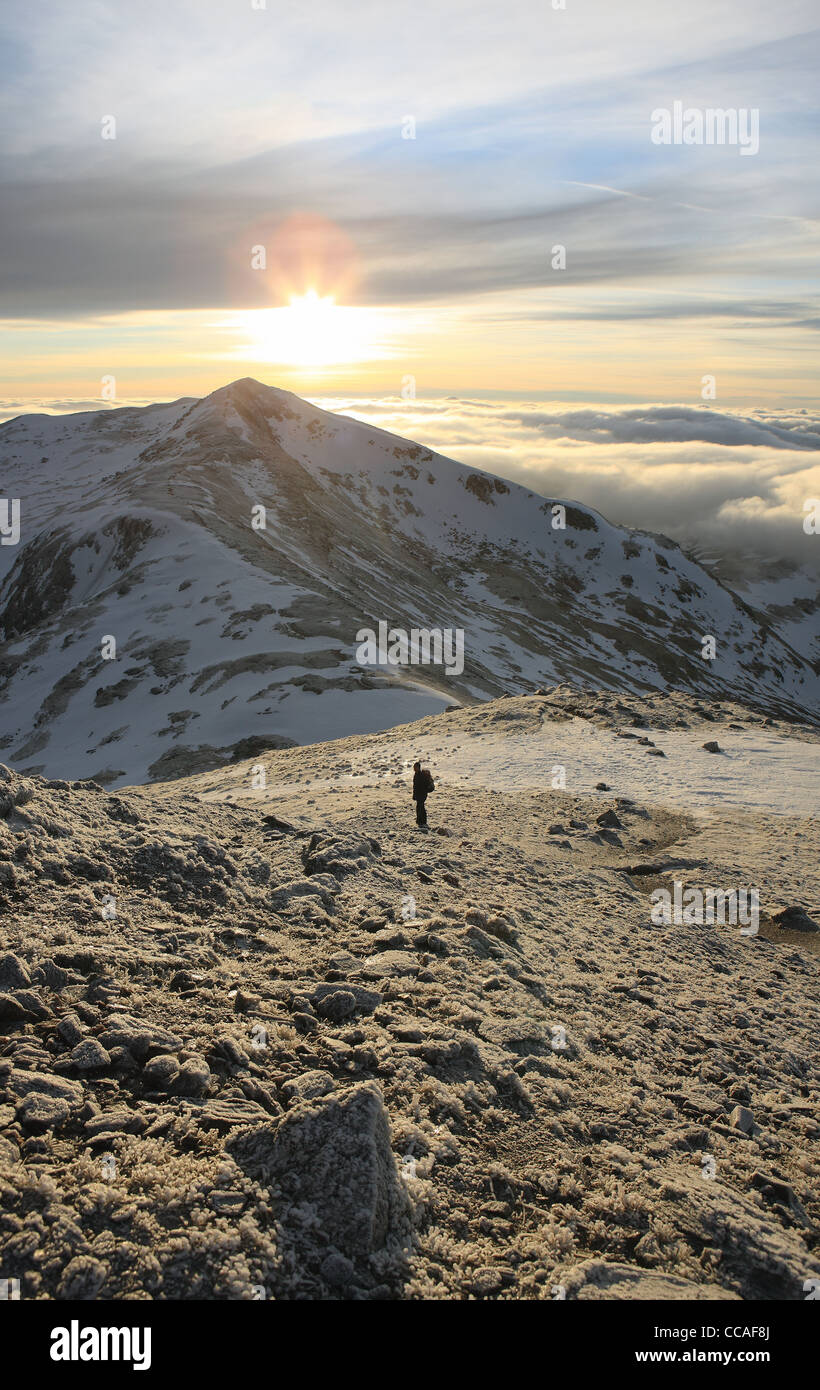 walker-crossing-a-snowy-lawers-ghlas-col