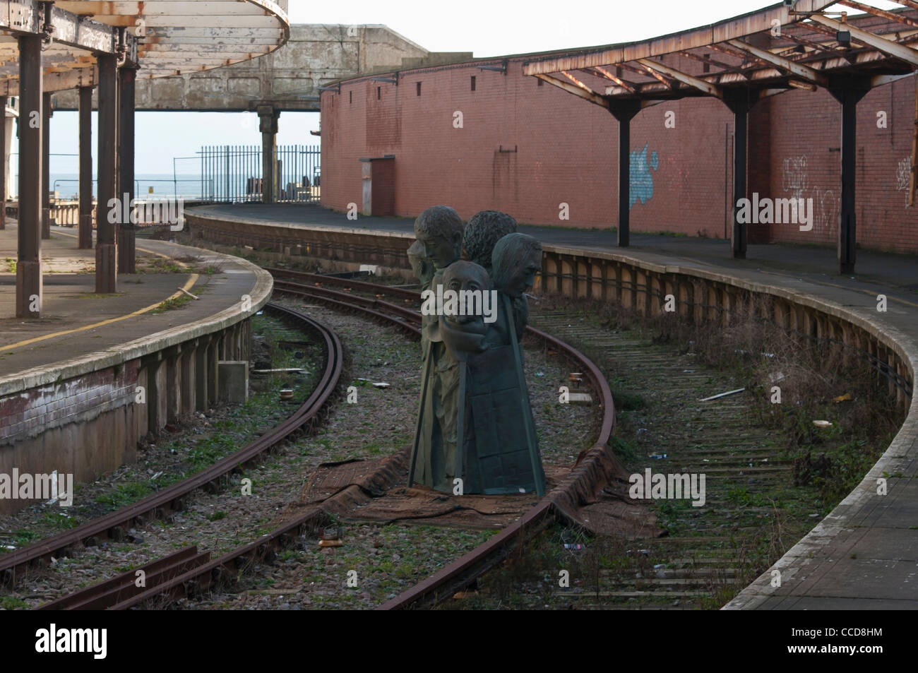 Statue In Disused Run Down Closed Railway Lines Track