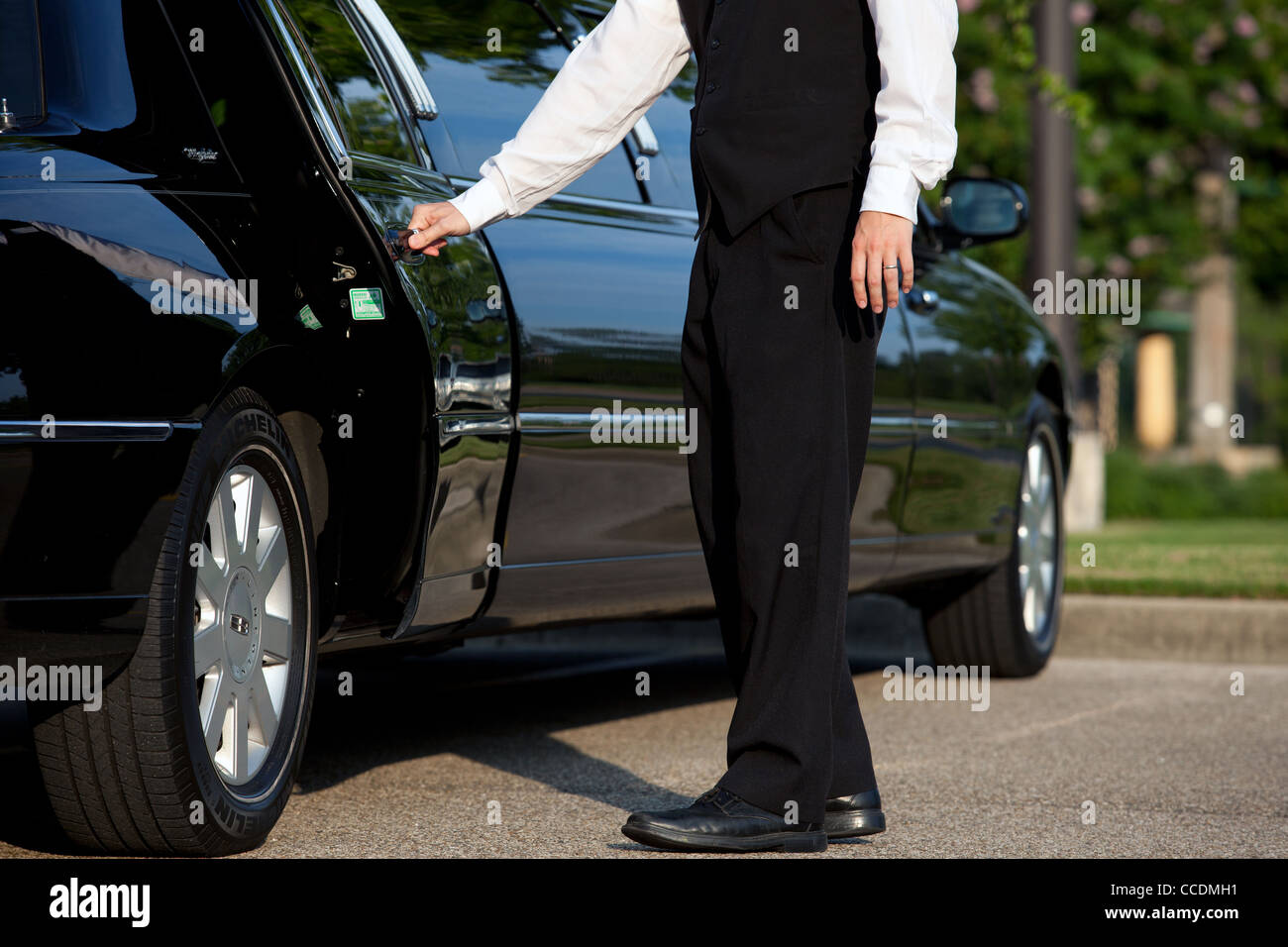a-chauffeur-opens-the-door-of-a-limousin