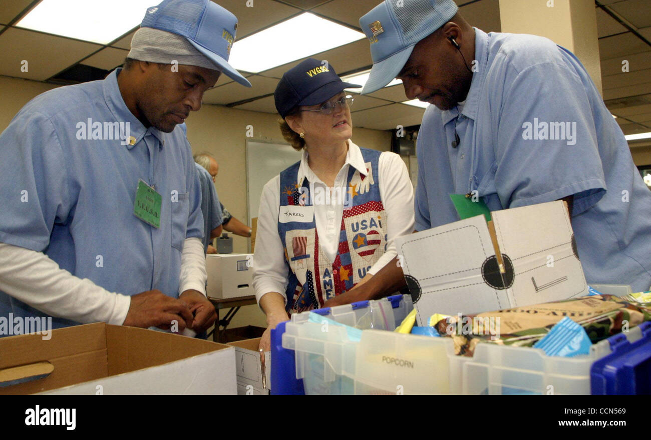 Operation Mom member Karen Nixon (cq)(center), of Antioch, works with inmates and V.V.G.S.Q. members (Vietnam Veterans Stock Photo