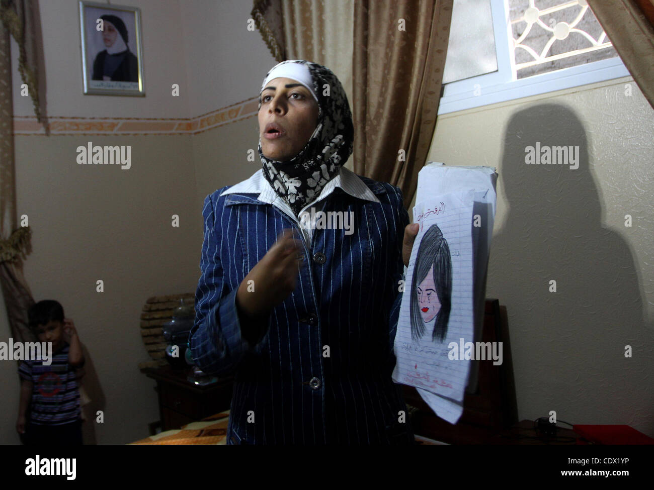 Oct. 19, 2011 - Gaza City, Gaza Strip, Palestinian Territory - Freed Palestinian prisoner Wafa Albes displays her Stock Photo