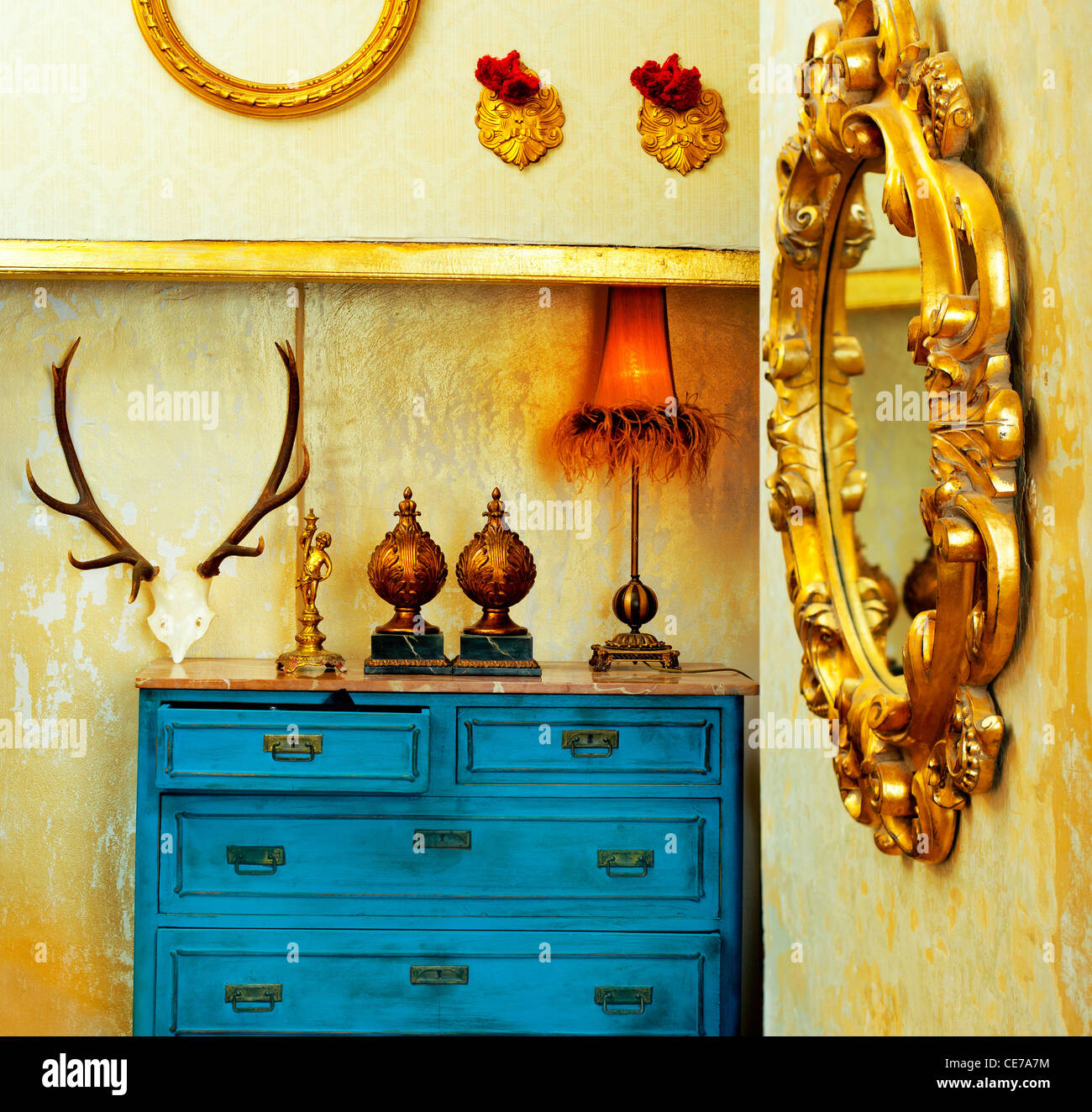 baroque grunge vintage house with blue drawer and golden mirror Stock Foto