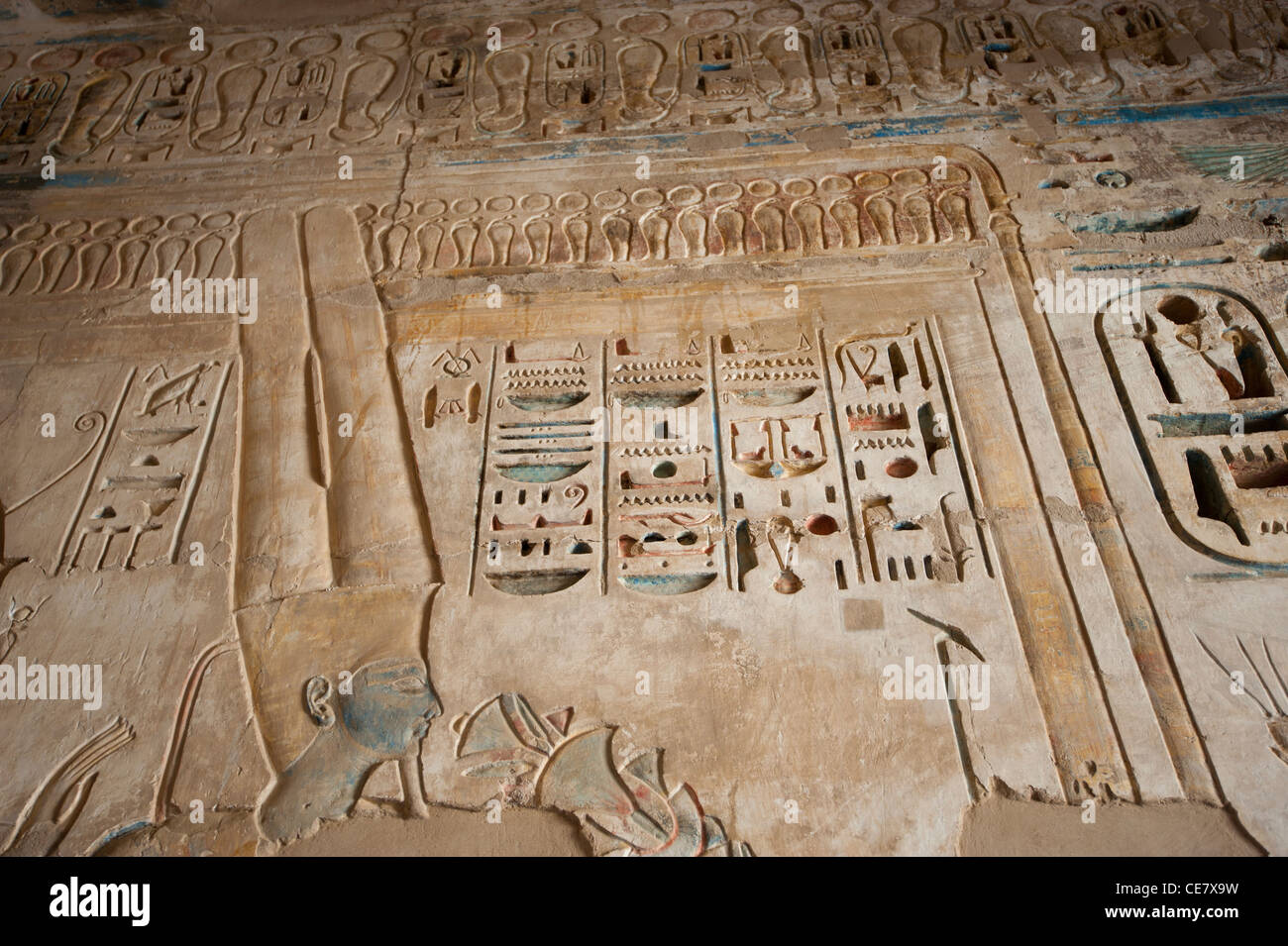 Egyptian hieroglyphic carvings and paintings on wall of