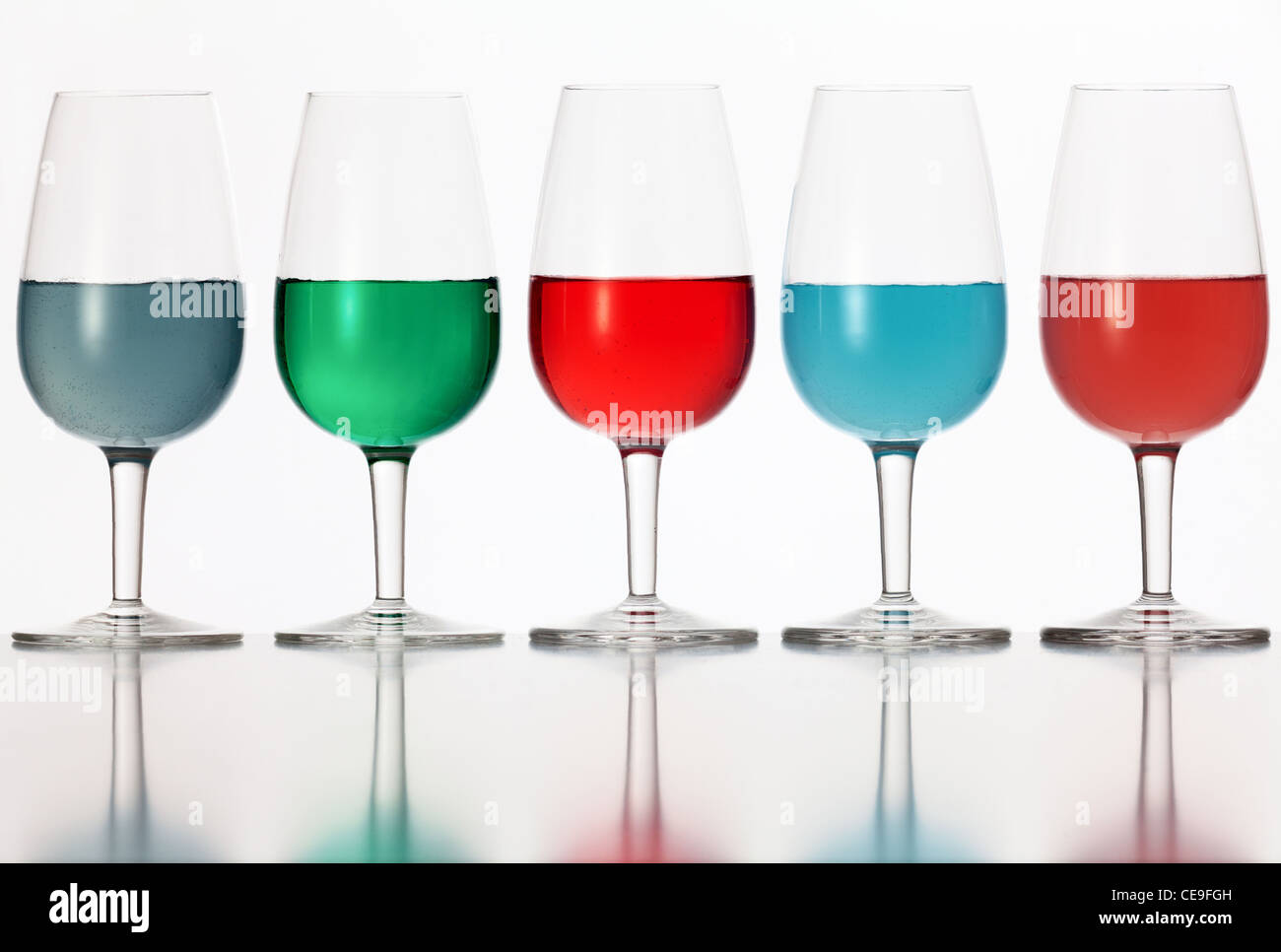 glasses of colored liquid photographed on a white background Stock Foto