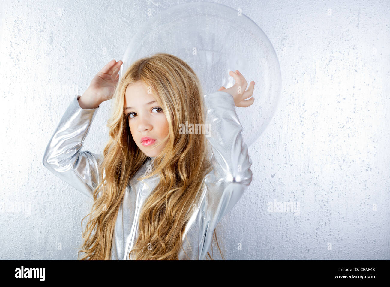 futuristic little girl with space suit Stock Photo ...