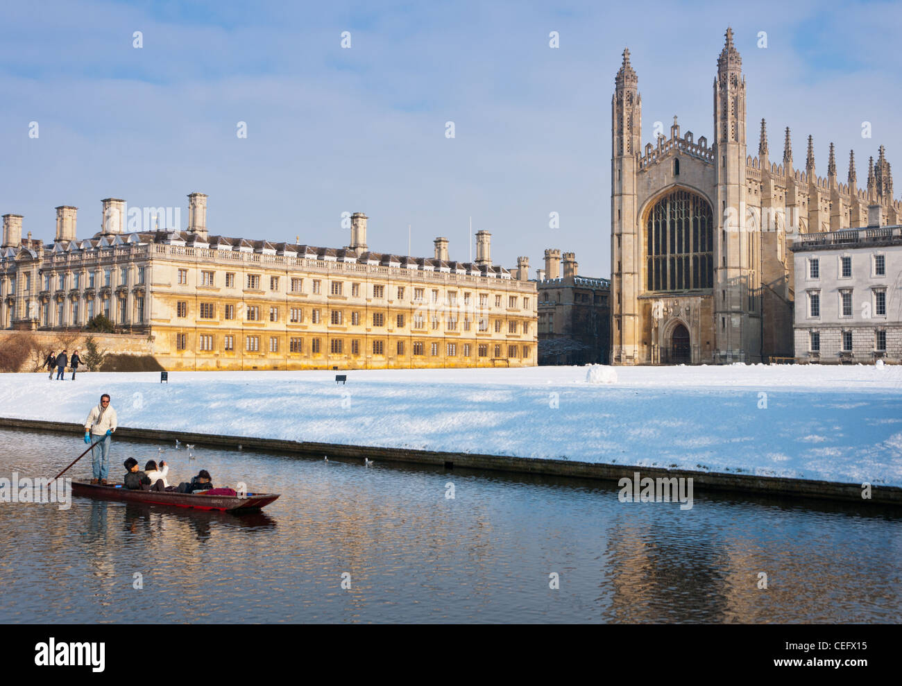 punting-along-river-cam-in-winter-snow-w