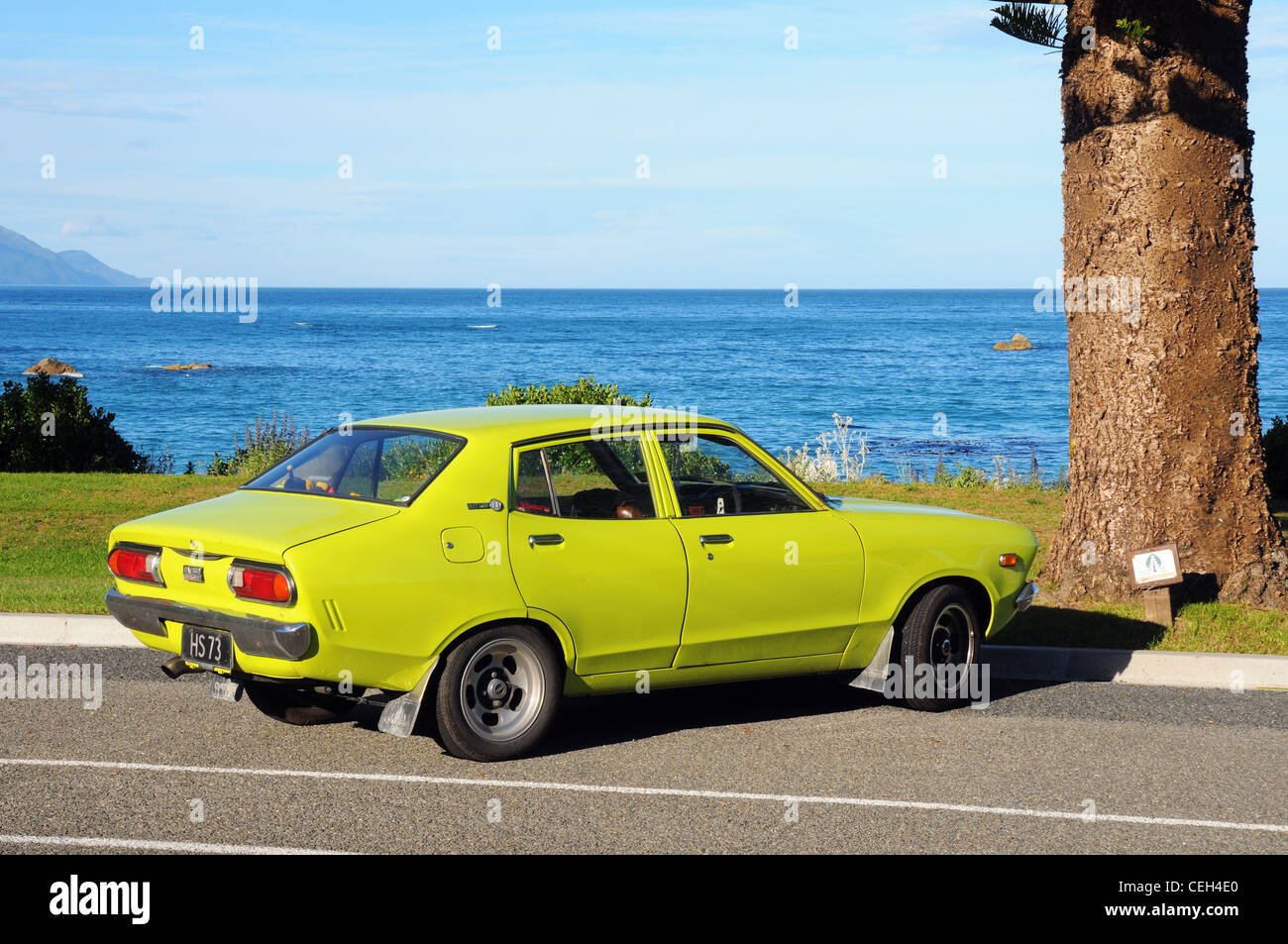 A Datsun 120Y parked on the seafront at Kaikoura in New ...