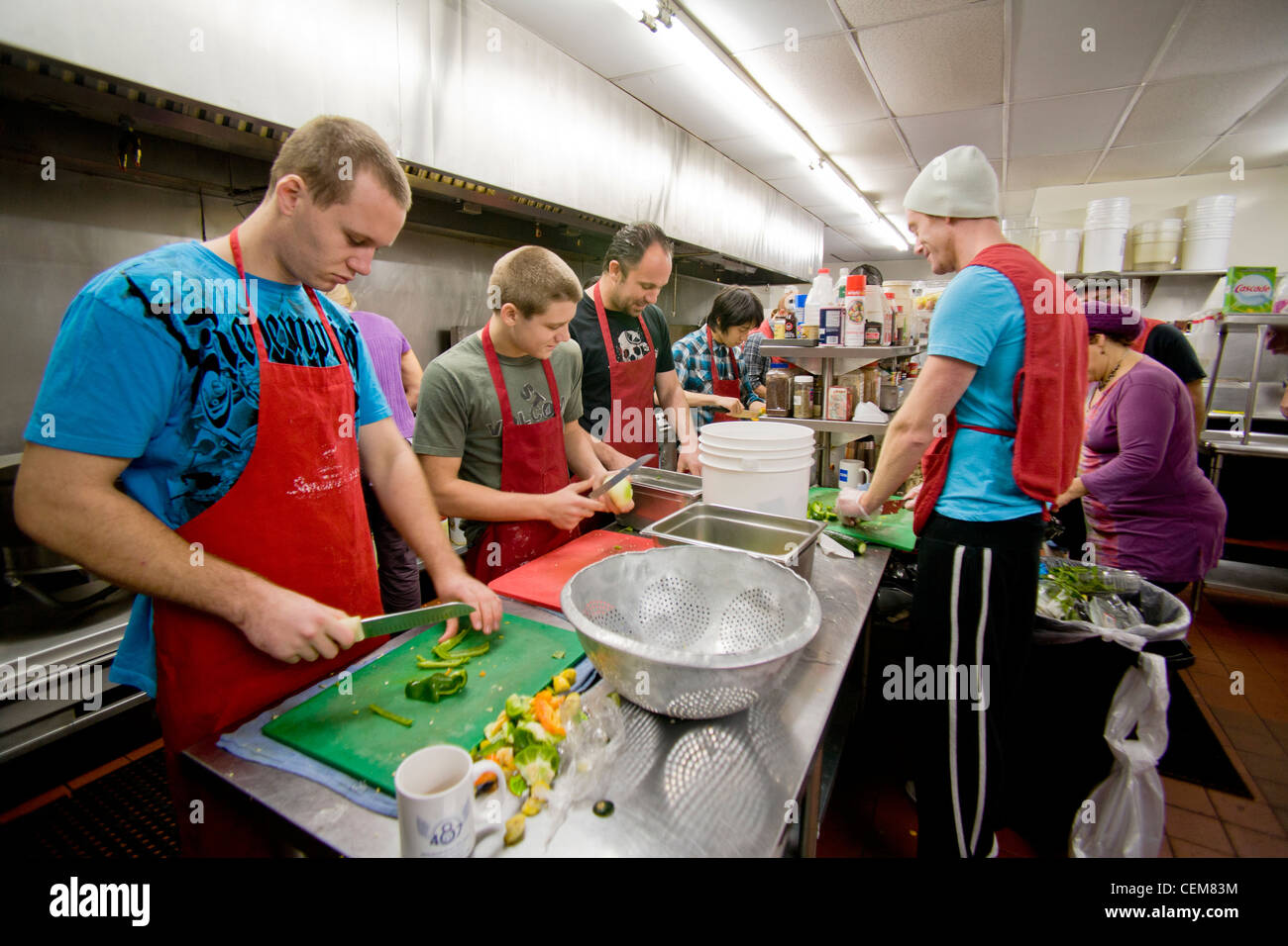 good Soup Kitchen In Costa Mesa #5: Middle class charitable volunteers pitch in at a Costa Mesa, CA, soup kitchen to feed the homeless.