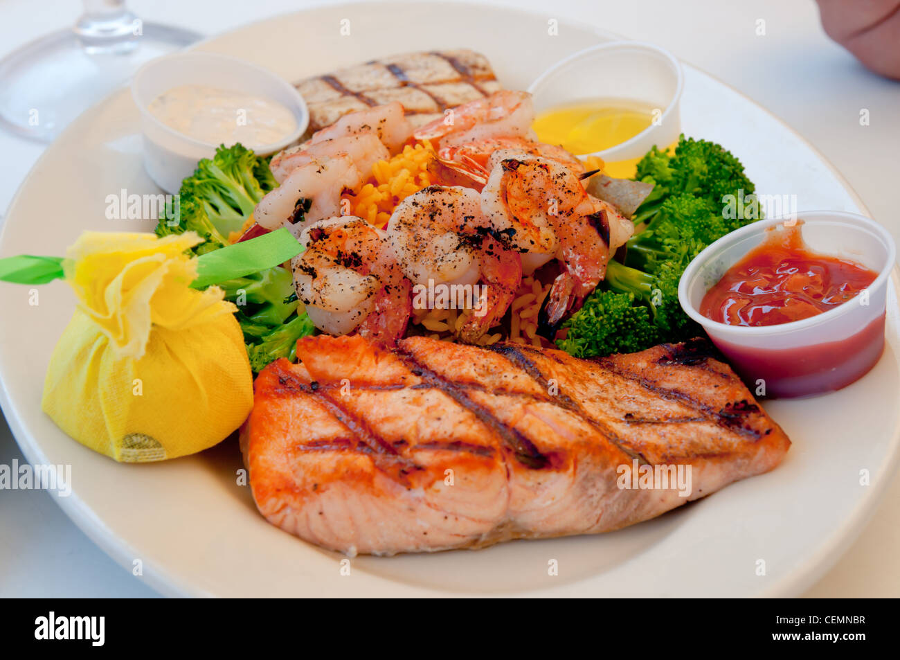 Seafood plate with tilapia grill fish shrimps rice and for Fish and grill