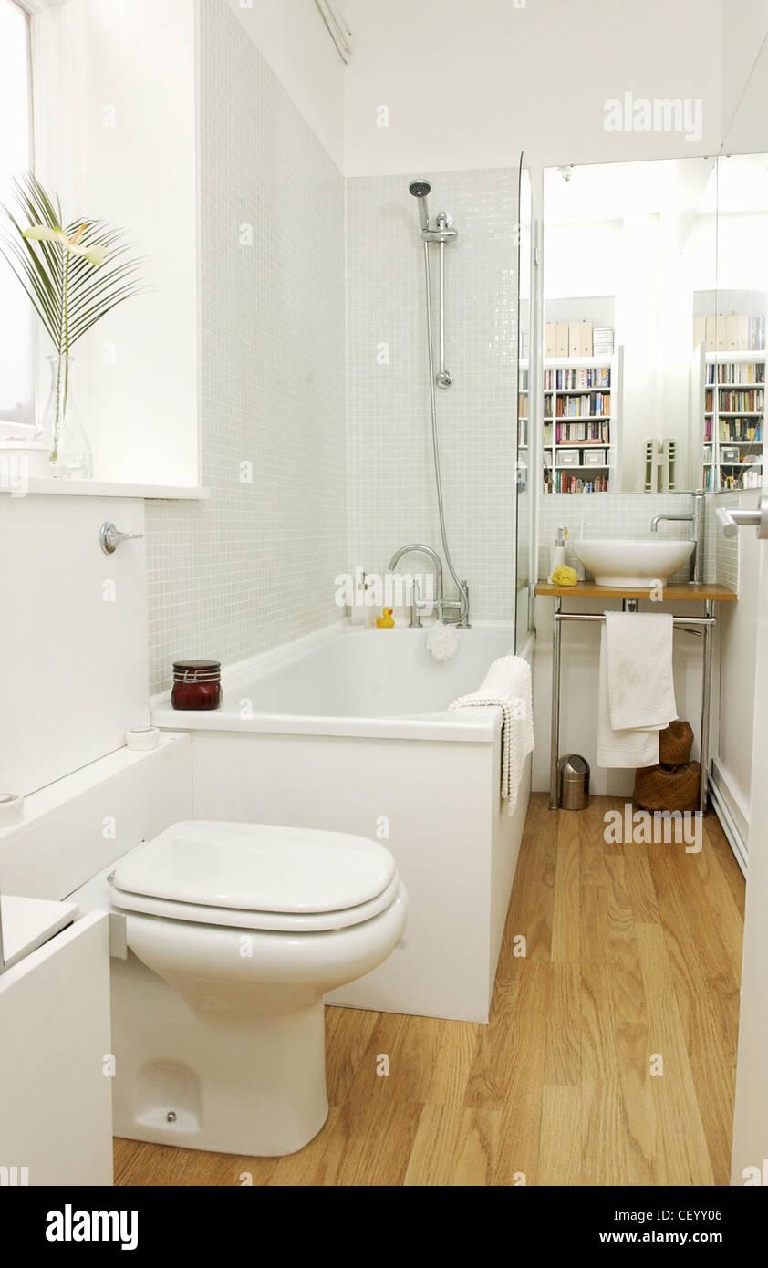 Renovated flat interiimage of bathroom white mosaic tiling for Mosaic bathroom bin