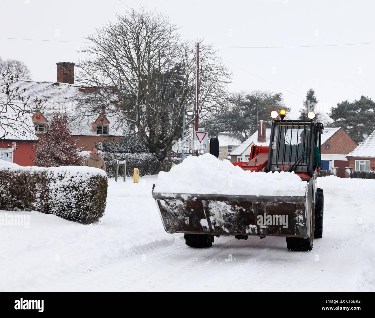 earth-mover-shifting-snow-milton-cambrid
