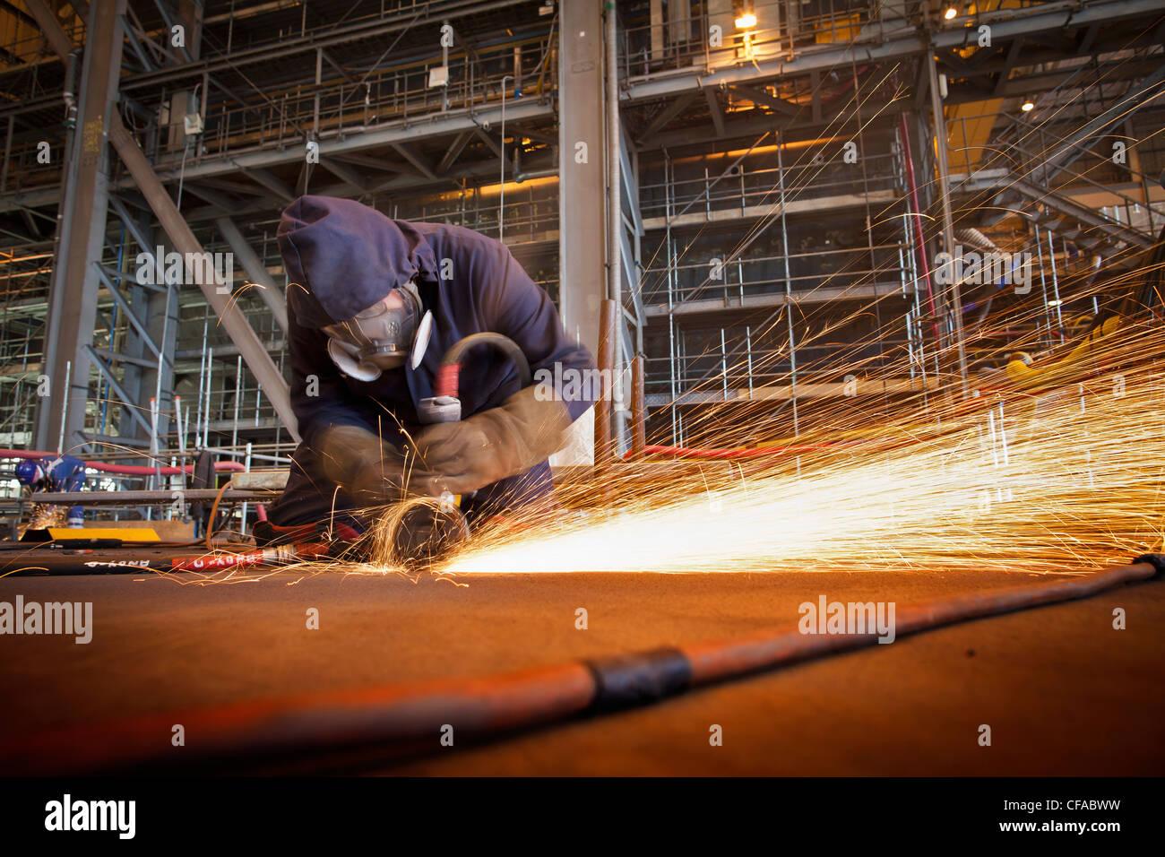 Steel cutter at work in shipyard Stock Foto