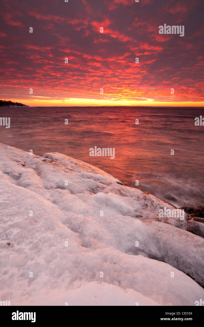 Icy coastline and colorful skies at dusk at Larkollen in Rygge, Østfold fylke, Norway. Stock Foto