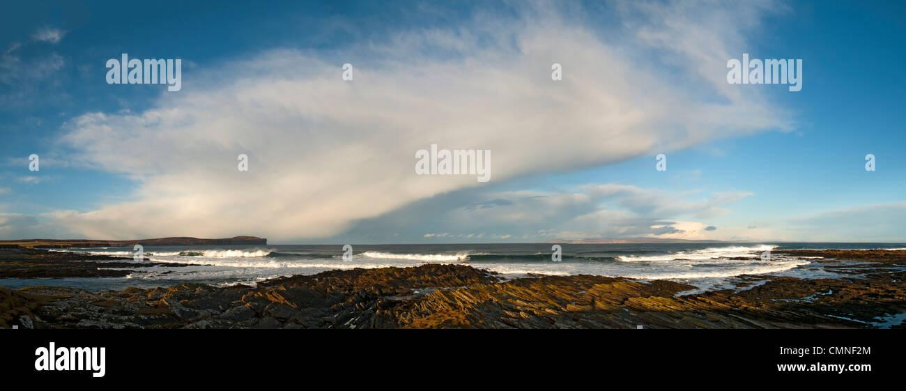 Cumulonimbus shower cloud over the Pentland Firth, Caithness, Scotland, UK. Dunnet Head on left and Hoy, Orkney Stock Photo