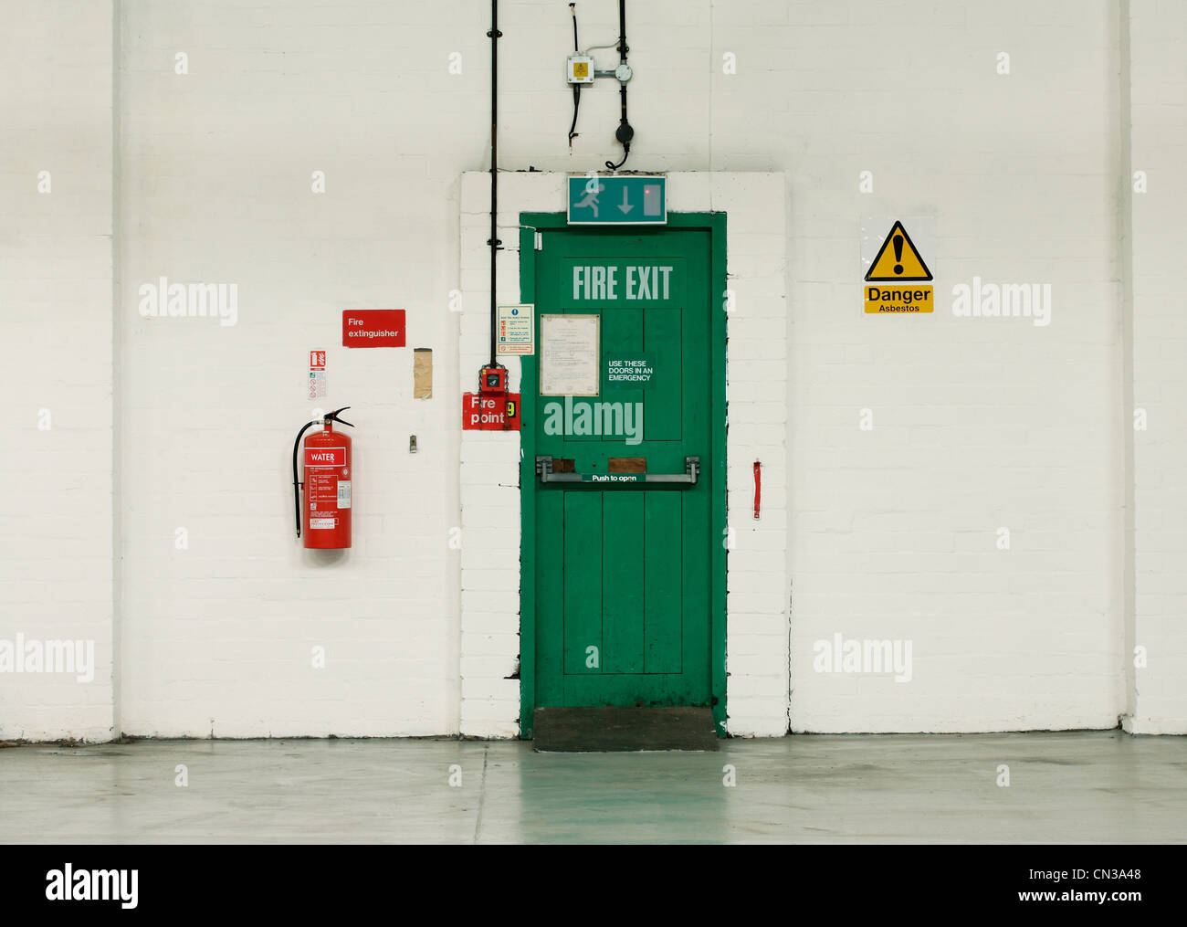 Fire Exit Door And Signs In Industrial Building Stock