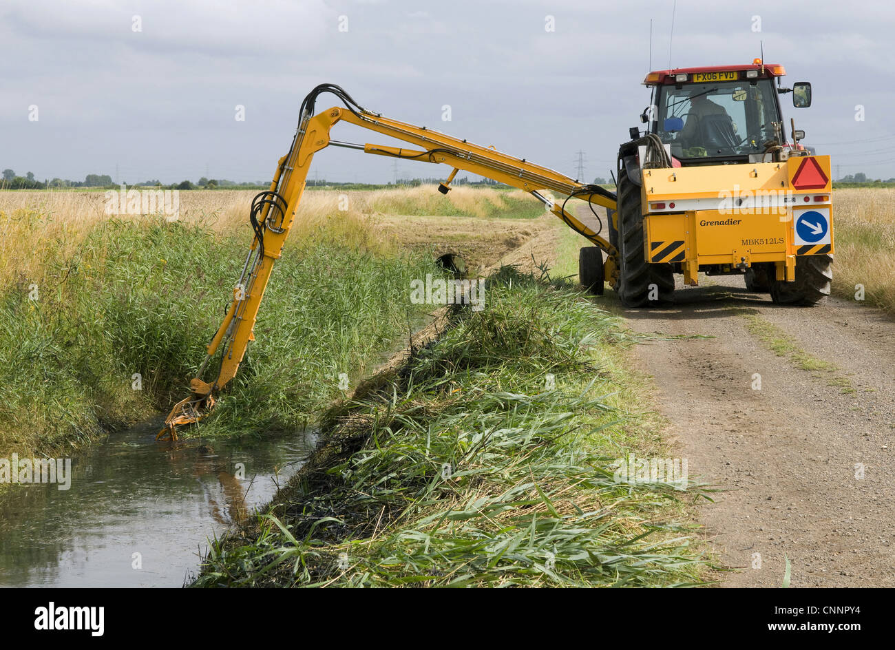 Tractor Bucket Lift Arms : Tractor boom arm clearing reed overgrown dyke countryside