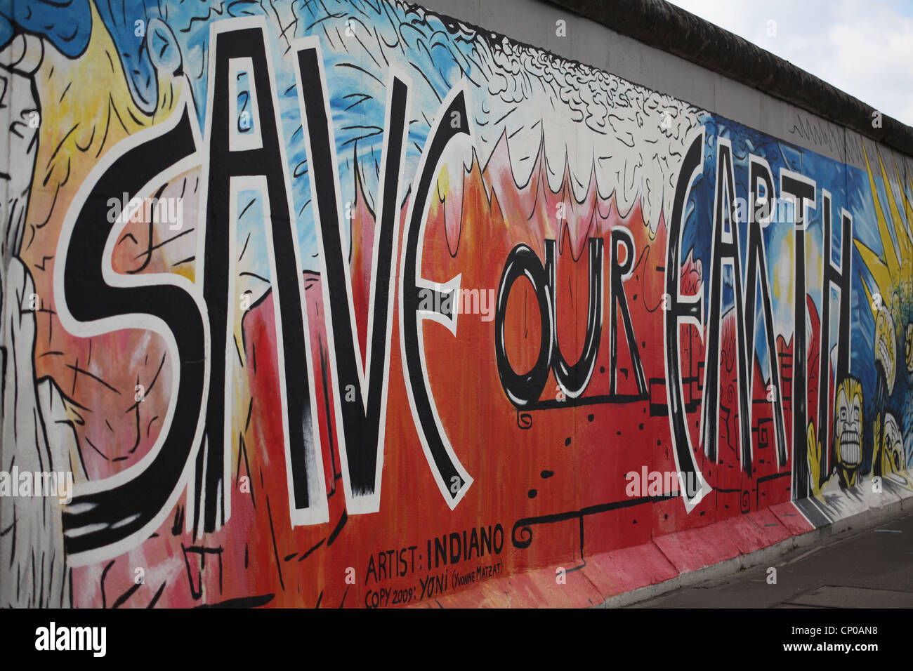 berlin wall east side gallery save our earth by indiano stock photo royalty free image. Black Bedroom Furniture Sets. Home Design Ideas