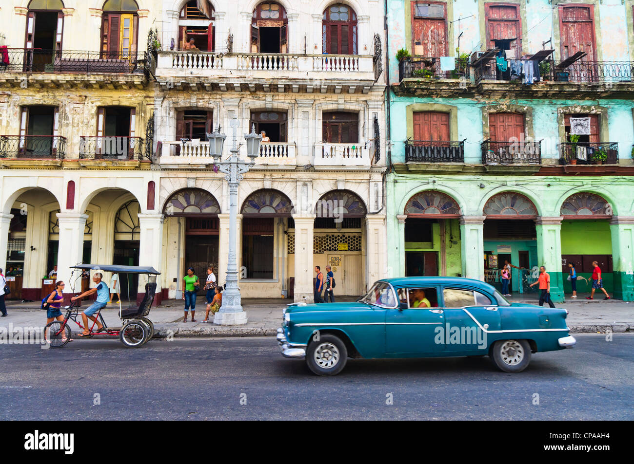 havana-cuba-street-scene-with-old-car-and-worn-out-buildings-CPAAH4.jpg