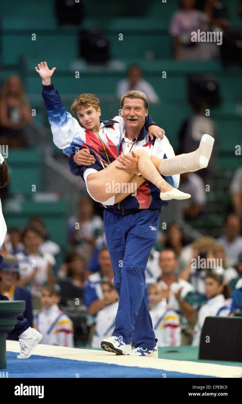 Bela Karolyi USA Coach carries Kerri Strug (USA) with her ...