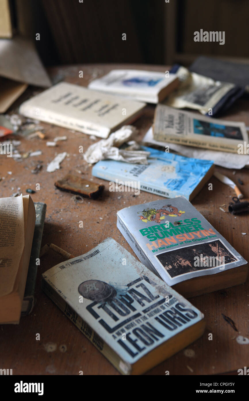 books-and-cigarettes-in-an-abandoned-hou