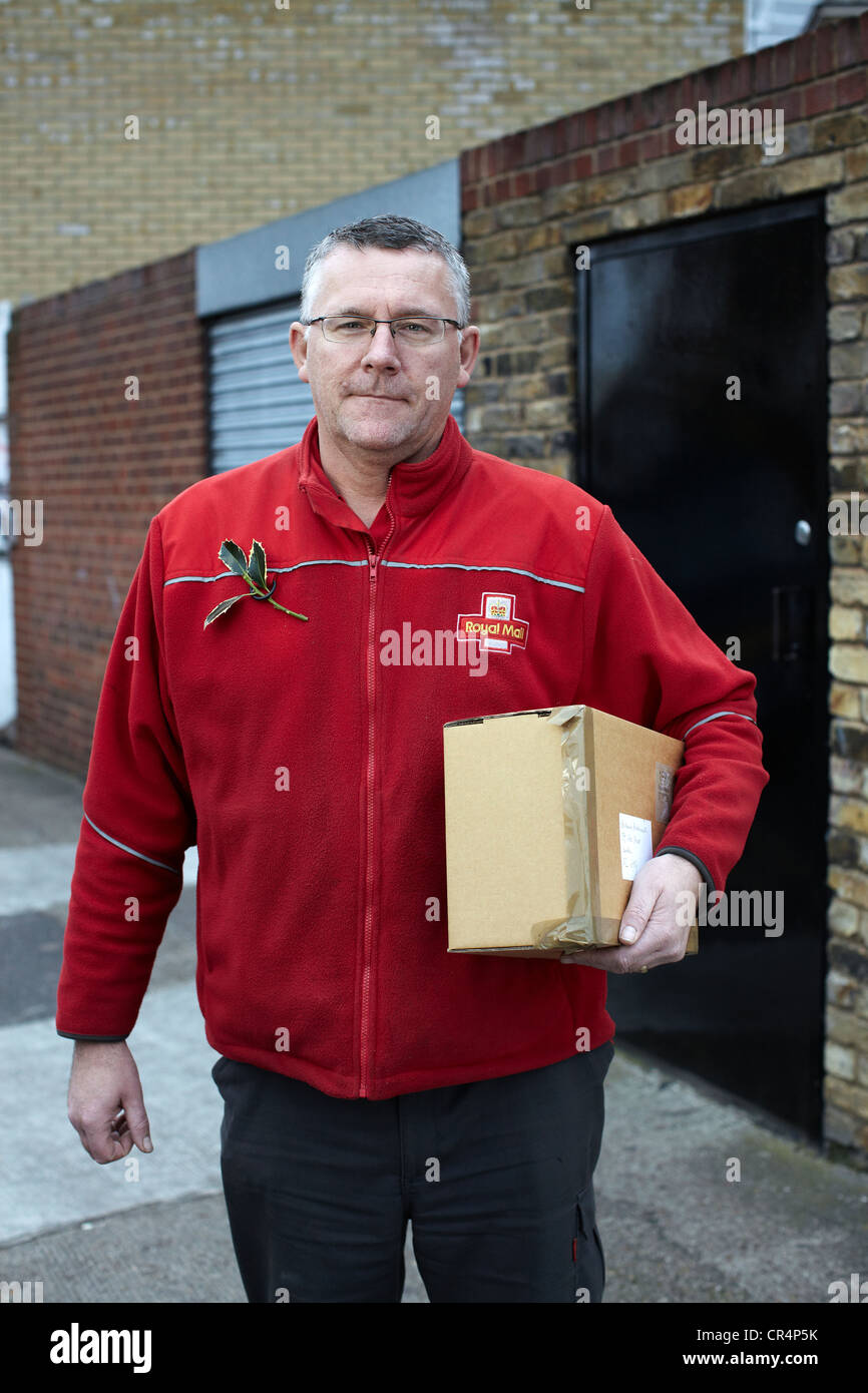 The Great British Postman Postal Worker On Streets Of Uk Cr Alamy